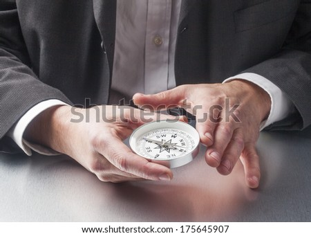 compass in business hands - stock photo