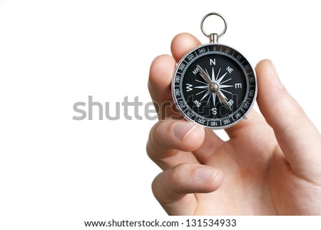 compass in hand on a white background close-up - stock photo