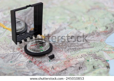 Compass on a hiking map of the Berchtesgaden Alps - stock photo
