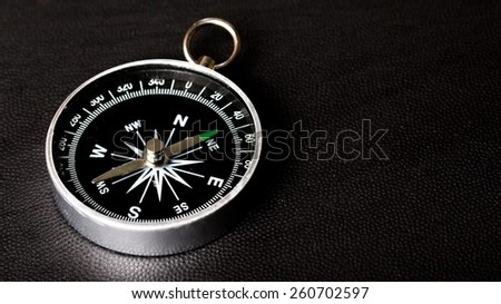 compass on  black board background - stock photo