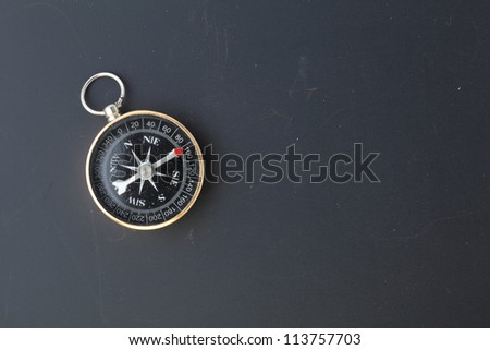compass on  blackboard background - stock photo