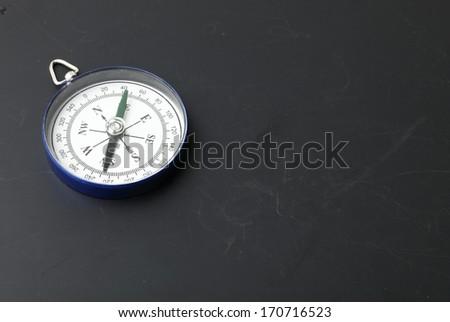 compass on  blackboard background - stock photo