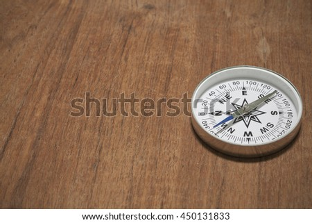 Compass on old wood background - stock photo