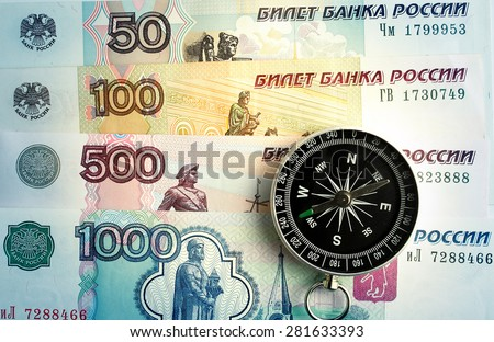 Compass on the background of banknotes - stock photo