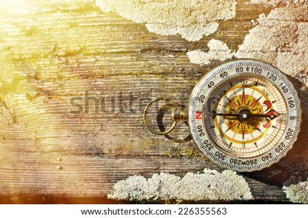 Compass on the wooden background - stock photo