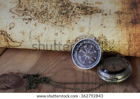 Compass on vintage map. Retro style. - stock photo