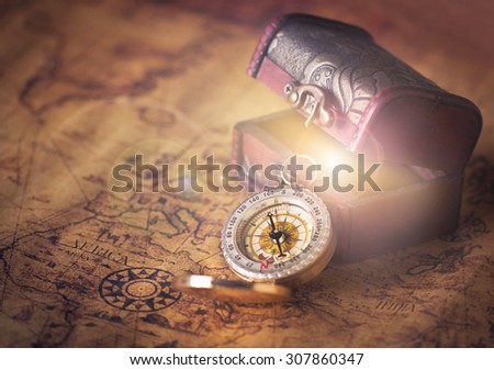 compass on vintage map with treasure Chest - stock photo