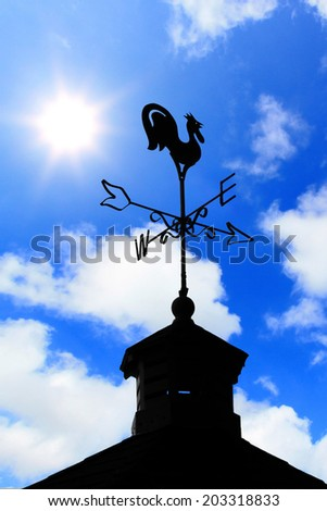 compass symbol with sky - stock photo