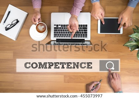 COMPETENCE  ( Skill Ability Proficiency Accomplishment) man touch bar search and Two Businessman working at office desk and using a digital touch screen tablet and use computer, top view - stock photo