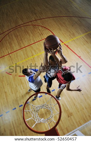 competition cencept with people who playing and exercise  basketball sport  in school gym - stock photo