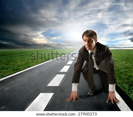 competition concept: business man starting a running - stock photo