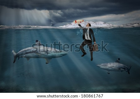 Competitive business concept with businessman swimming among sharks in stormy seas - stock photo