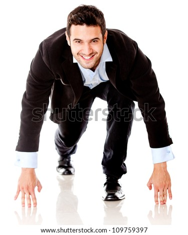Competitive business man ready to start running - isolated over white - stock photo
