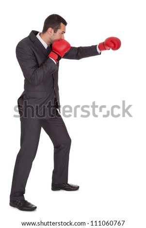Competitive businessman in boxing gloves. Isolated on white - stock photo