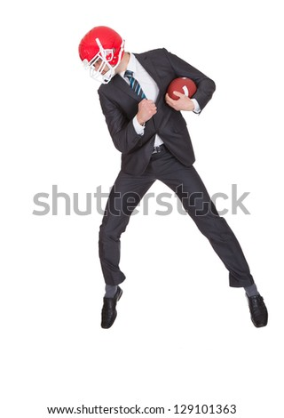 Competitive businessman playing american football. Isolated on white - stock photo