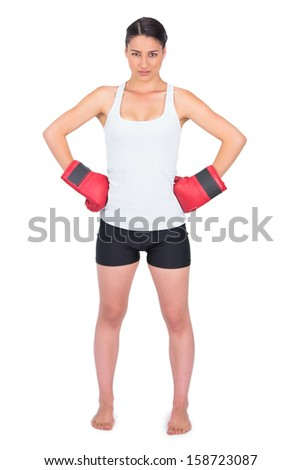 Competitive young model with boxing gloves posing on white background - stock photo