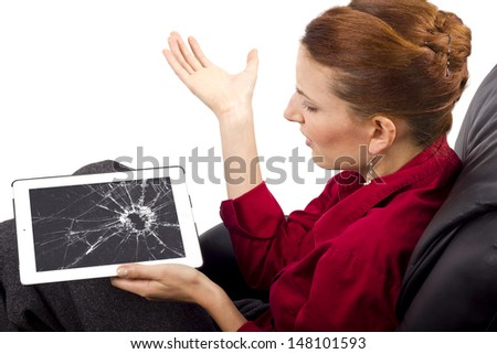 complaining about a broken tablet screen - stock photo