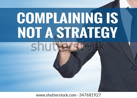 Complaining is not a Strategy word Business man touching on blue virtual screen - stock photo