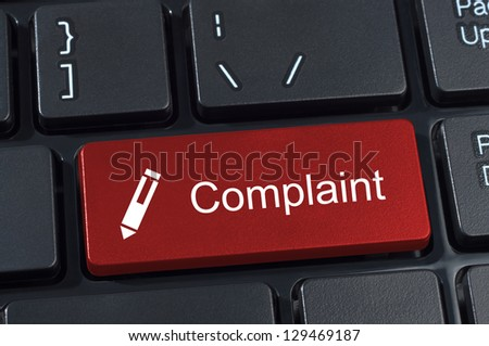 Complaint button keyboard with pen icon internet concept. - stock photo