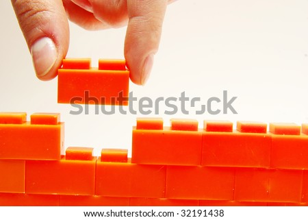 compleeting the wall - stock photo