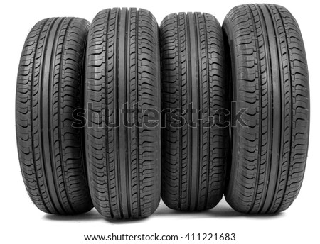 Complete set of new tyres for car on white background - stock photo