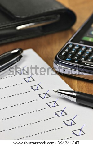 completed checklist in office - stock photo