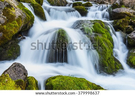 completely natural spring water - stock photo