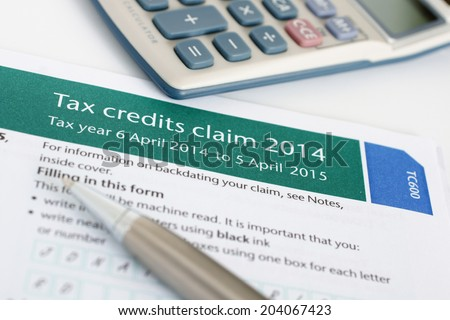 Completing a British tax credit application form (TC600) concept   - stock photo