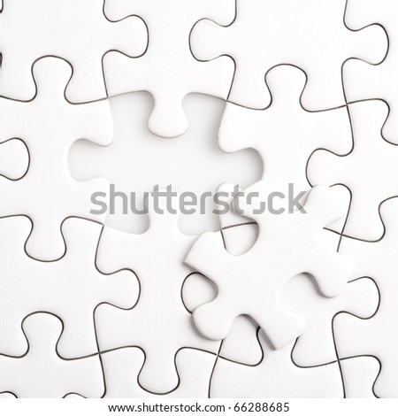 Completing the missing Jigsaw puzzle concept for business with completing the team with final person - stock photo