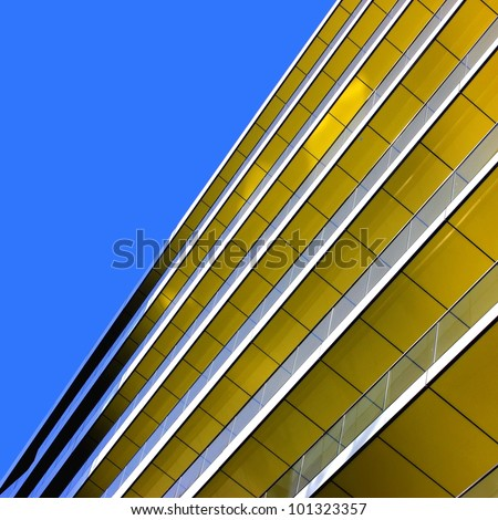 Complex building structural detail, yellow metal bars and glass - stock photo