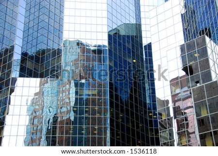 Complex pattern reflecting in a glass skyscraper wall in downtown Montreal, Canada - stock photo