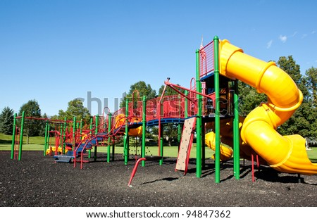 Complex playground set in well-maintained park - stock photo