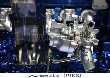 Complex silver and blue engine of modern car interior view - stock photo