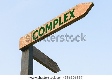 COMPLEX word on wood roadsign - stock photo