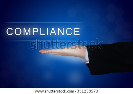 compliance button with business hand on blue background - stock photo