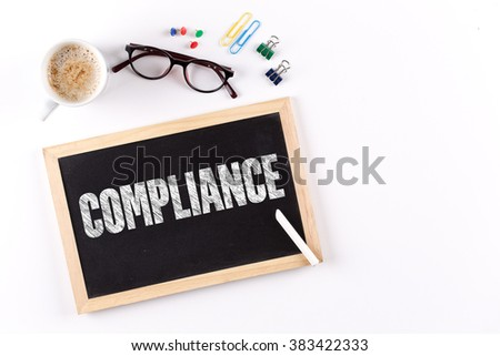 COMPLIANCE word on Chalkboard with Coffee Cup, view from above - stock photo