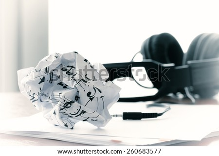 composing music concept with shallow DOF evenly matched crumpled musical notes paper - stock photo