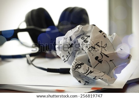 composing music concept with shallow DOF evenly matched crumpled musical notes paper and exposure bokeh - stock photo