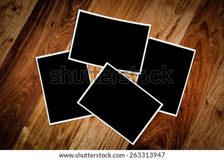 Composite empty photo frame with places for your photo in a wood background  - stock photo