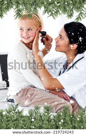 Composite image of a Cute little girl attending a medical checkup against snow falling - stock photo
