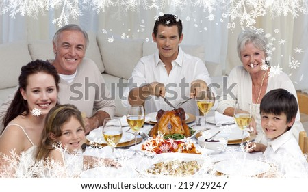 Composite image of a Family eating turkey and vegetables in a celebration meal against frost - stock photo