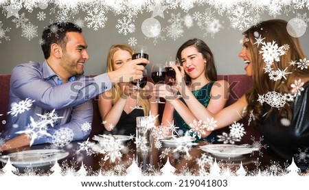 Composite image of a Happy friends drinking red wine in a bar against snow - stock photo