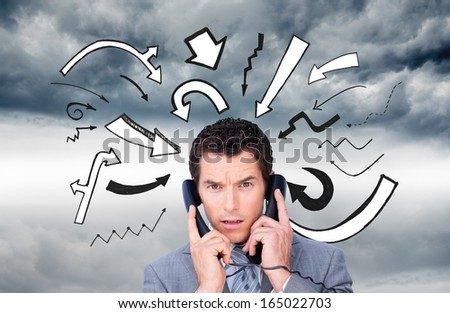 Composite image of angry businessman tangle up in phone wires - stock photo