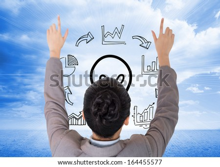 Composite image of Asian businesswoman pointing - stock photo
