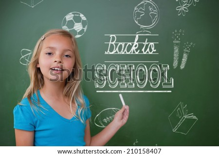 Composite image of back to school message against cute pupil holding chalk - stock photo