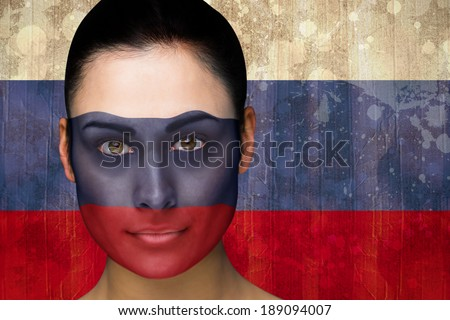 Composite image of beautiful football fan in face paint against russia flag in grunge effect - stock photo