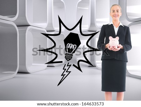 Composite image of blonde businesswoman holding pink piggy bank - stock photo