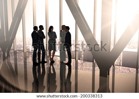 Composite image of business colleagues talking in large room overlooking city - stock photo