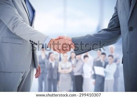 Composite image of business handshake - stock photo