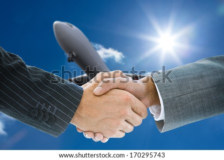 Composite image of business handshake against 3d plane flying in the sky - stock photo
